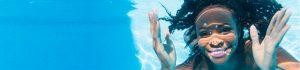 black woman swimming in pool
