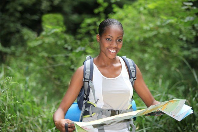 black woman hiking w map