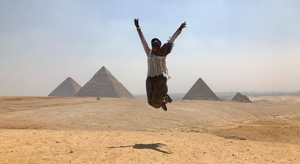 A Black woman jumping for joy in Cairo Egypt
