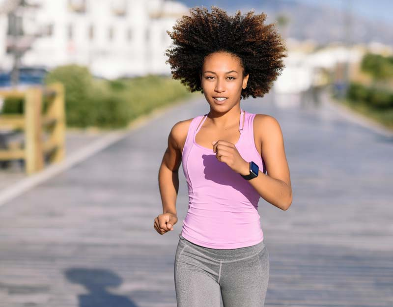 Black woman running with sweat in the sun