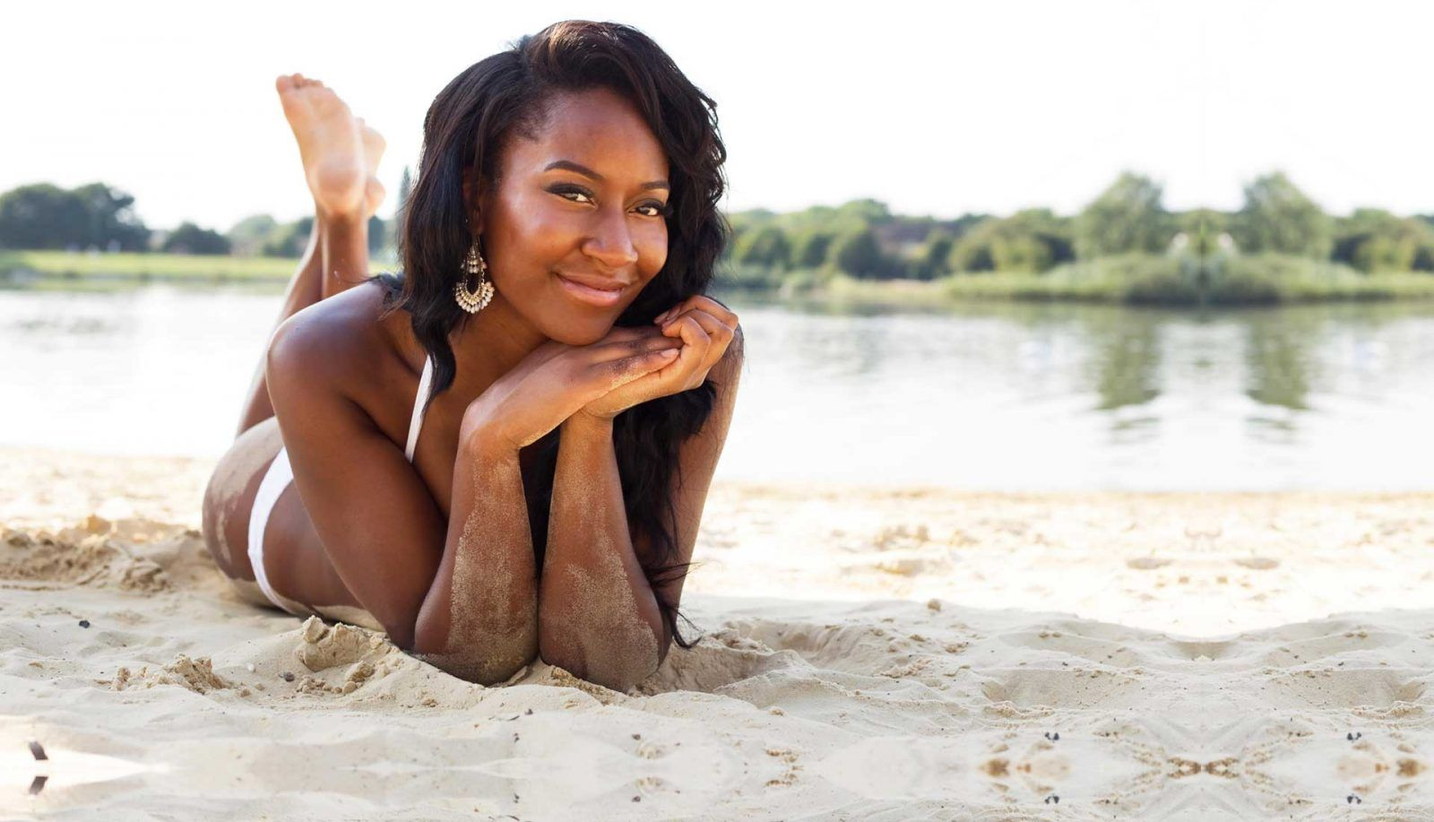 Black woman on beach after swimming with natural hair